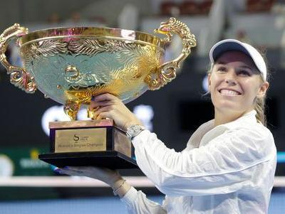 Tennis: Wozniacki swats aside Sevastova to wear Beijing crown