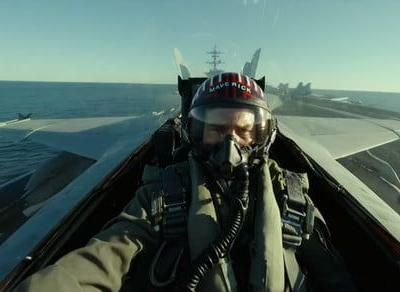 Tom Cruise surprises Comic-Con crowds with first Top Gun: Maverick trailer
