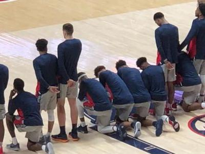 Mississippi basketball players kneel during anthem in response to Confederate rally near arena
