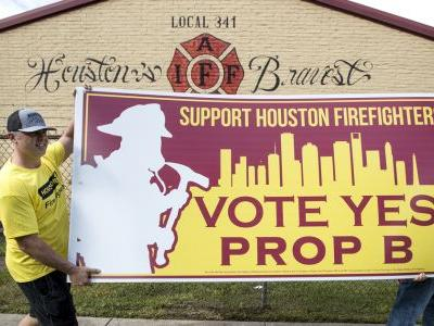 Houston firefighters take battle over pay to voters