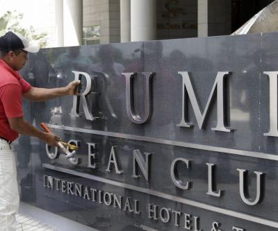 Judge, police help oust Trump Hotels from Panama property