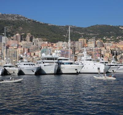 28 photos show how the 1% live it up at the Monaco Yacht Show, from cruising in on helicopters to partying aboard multi-million dollar yachts