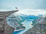 Daredevil performs a somersault and other brave stunts on Norway's famous Troll's Tongue rockface