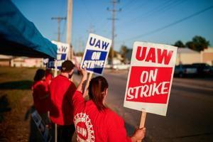 GM deal with UAW on health care costs may help end strike, hurt Ford