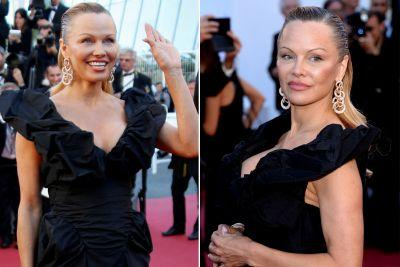Pamela Anderson tones down look on the Cannes red carpet