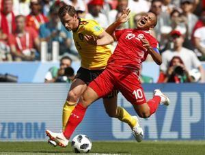 AP PHOTOS: Germany salvages campaign on Day 10 of World Cup
