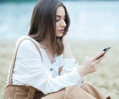Should You Tell Your Partner If Your Ex Texted You? Experts Say It's Up To You
