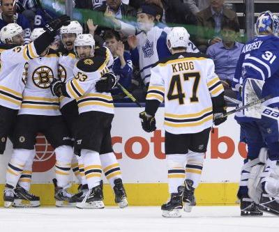 Bruins hold off late Maple Leafs rally to even series