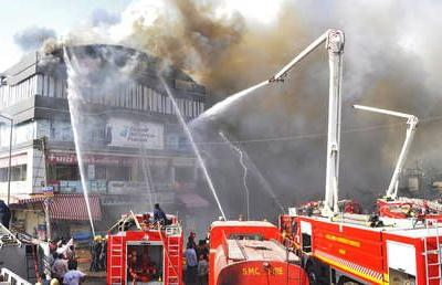 Students jump off roof in horrific India center fire, at least 18 confirmed dead