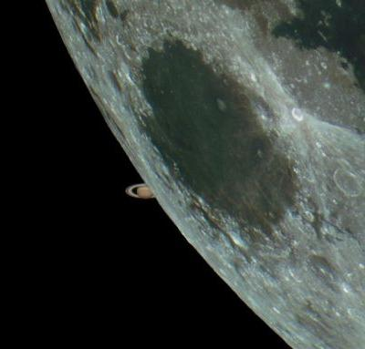 Here's a Photo of Saturn Peeking Out from Behind the Moon