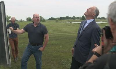 120 Foot Ankeny Wind Turbine Draws Visitor Pledging to Fight Climate Change