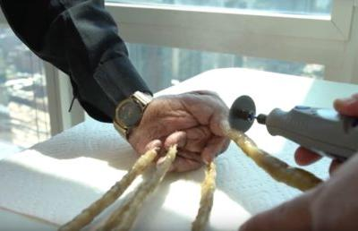 Indian man with world's longest fingernails has them clipped & put on display in New York