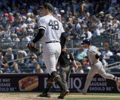 Yankees lose Tanaka early, first-place late in crushing day