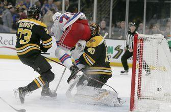 Bruins goalie Rask leaves game after collision vs. Rangers