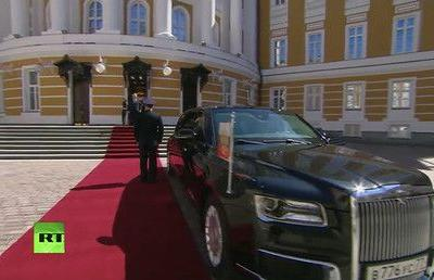 Putin rides in new, long-rumored state car at inauguration ceremony