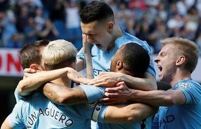 Back on top: Guardiola hails players after Manchester City beat Spurs to top the Premier League