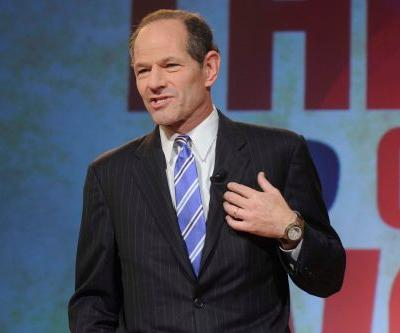 Eliot Spitzer on landlord duty at New York Fashion Week