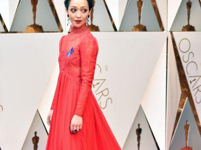 Why Is Ruth Negga Wearing A Blue Ribbon On Her Oscars Gown?