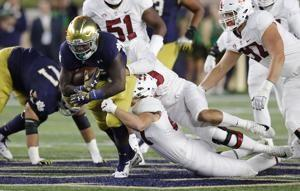 Book, defense lead No. 8 Irish past No. 7 Cardinal