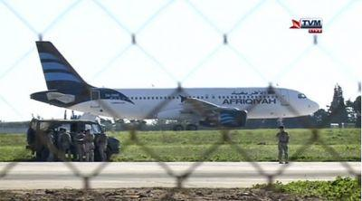 Hijackers threaten to blow up Libyan plane diverted to Malta