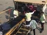 Passenger films baggage handlers throwing luggage as they unload suitcases at Hong Kong airport