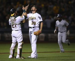 A's edge Mariners to pull within 1 game of 1st in AL West