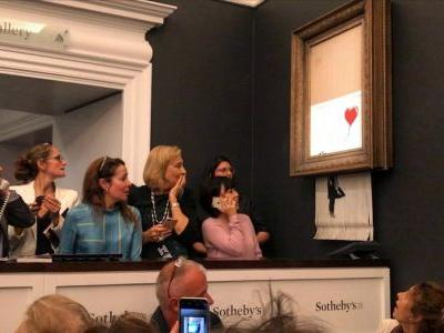 Banksy painting uses hidden shredder to destroy itself after auction