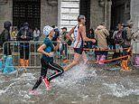 Venice marathon goers are forced to run through flooded streets