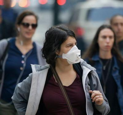 People are donning respirator masks as air quality worsens in San Francisco, and it's locking them out of Face ID