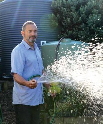 How to set up a rainwater collection system in a small garden