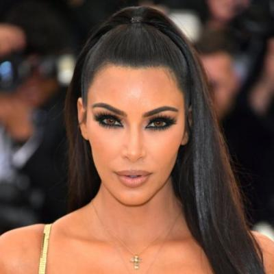 Kim Kardashian's All-Gold Met Gala Beauty Look Included Bronze-Colored Contacts