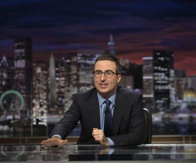 John Oliver buys Russell Crowe's $7,000 leather jockstrap to give to a Blockbuster in Alaska