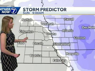 Snow with patchy freezing drizzle Sunday morning