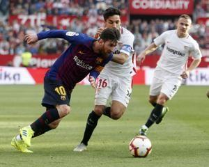 Messi scores 3 to earn Barcelona 4-2 victory at Sevilla