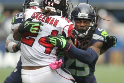 Thomas ends holdout, will report to Seahawks