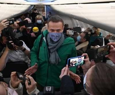 Alexei Navalny detained on return to Moscow five months after being poisoned