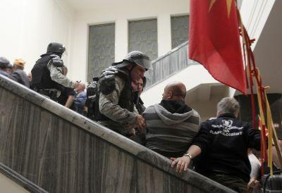 Protesters storm Macedonia's parliament, attack lawmakers over leadership vote