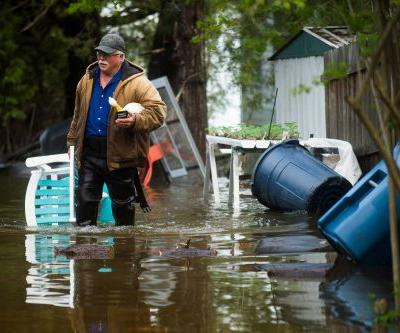 Thousands evacuate area in Michigan after two dams fail following heavy rains and floods