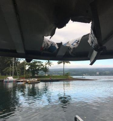 An explosion from a Hawaii volcano sent a 'lava bomb' through the roof of a tourist boat, injuring passengers