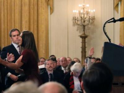 The moment a White House intern confronted CNN White House correspondent Jim Acosta during a tense exchange with Trump, in 3 photos