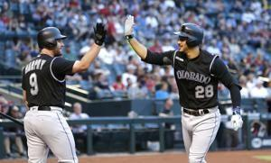 Arenado, Senzatela lead Rockies to rout of D-backs