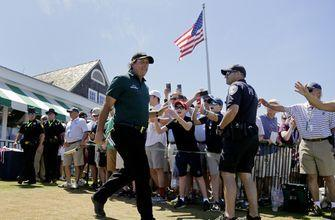 Mickelson penalized for swatting moving ball with putter
