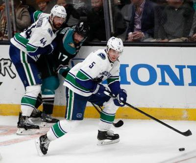 Ducks top Canucks 1-0 in Murray's debut to end losing streak