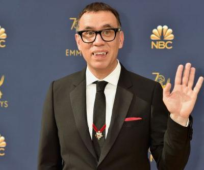 Fred Armisen wears vampire fangs on the Emmys red carpet