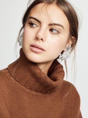 15 Statement Earrings That Look Good With a Cocktail Dress-and Even Better With Jeans