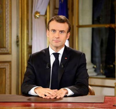 Emmanuel Macron says the 'legitimate anger' of the 'yellow vest' protests led him to raise the minimum wage and cut taxes