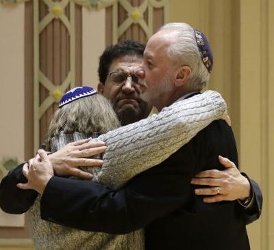 'He didn't see us, thank God': Survivor of synagogue massacre recounts moments of terror