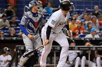 Bour and Realmuto help Marlins top Dodgers in Game 2