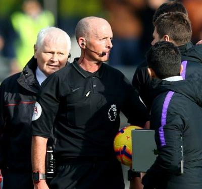 Pochettino given two-match touchline ban and £10k fine for row with referee Mike Dean