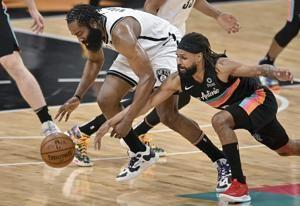 Harden's triple-double helps Nets escape in OT against Spurs